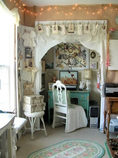 So much to love. Shutters as photo display. Lace pieces as curtains. Sweet desk. So much....