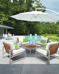 Montego Cocktail Table - Montego Chairs in Stainless Steel with Cushions - Outdoor - Room & Board