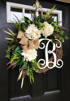 Gorgeous Elegant Year Round Door Wreath! Perfect for greeting your guests to your home with this one of a kind door wreath.  Made up on an 18 grapevine wreath with moss, mixed flowing greenery of ivies, boxwood, eucalyptus, hydrangeas leaves, ficus leaves, green hops and ferns. Beautiful cream hydrangeas with white accents. A decorative 12 ivory script monogram and beautiful burlap bow make this wreath one of a kind.  Measures approx: 28 x 25 x 7( tip to tip).  Choose the letter you would…
