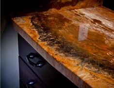 The solution to my dilemma!Epoxy counter top that looks like real granite.
