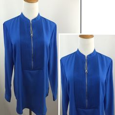 "Michael Kors Pleats Zipper Long Sleeve Shirt Excellent condition. Pleats front. Zipper closure. Logo buttons. Not sure if the zipper pull is missing-see up close pic. SZ M. Color: blue. Material: polyester. Approx measurements taken with item laying flat-no stretching-on one side. Bust(armpit to armpit): 20"". Length: 20"" not incl collar. Sleeve: 23.5"". Shoulder: 16"". Item:pma8.   1 business day handling - FAST SHIPPING. MICHAEL Michael Kors Tops"