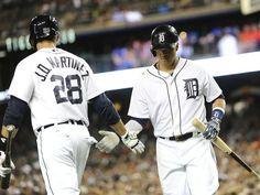 Tigers' J.D. Maritnez (28) congratulates Victor Martinez