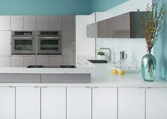 Blue, White and metal contemporary styled Dura Supreme Cabinetry kitchen design.