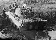 Tiger 332 carefully trying to make it's way out of the mud.