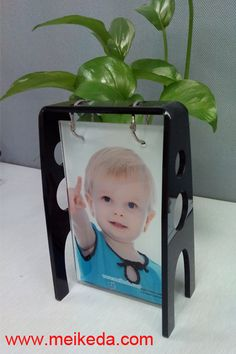 http://www.meikeda.com/dye-sublimation-printing-2/photo-gifts-from-photo-usa/toughened-glass-frame/item/glass-photo-w-black-acrylic-photo-stand-with-hooks.html?category_id=122