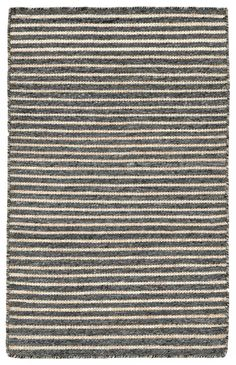 Simple stripe patterns combine with sophisticated blended colors in this Indoor/Outdoor flatweave. This flat weave reversible rug is easy to care for and great for any indoor outdoor space. Soft 100% Polyester is tightly hand woven by artisans in...