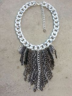 Check out this item in my Etsy shop https://www.etsy.com/listing/209620355/silver-fringe-necklace-statement
