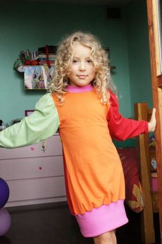 Learn to sew a nightgown cute and practical, made refashioning with pre-loved garments, using a free pattern (provided) for sizes 3-16 years.