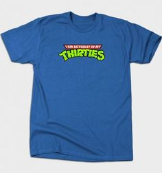 """Is he a kid in a man's body? Then this """"Actually in my Thirties"""" t-shirt is the gift for him. Grab at BustedTees (affiliate)."""