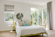 A whimsical guest bedroom brims with natural light