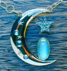 Custom design moon necklace in 14 karat white gold, featuring gorgeous moon stones and blue diamonds. This is a piece I made based off of a client's design that she had for years.