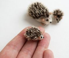 Tiny needle felted hedgehog. This little guy is just over 2 cm long and 1,5 cm wide. Made from wool and German mohair Made to order. You will get a very similar looking one. Processing time - about 14 days. Please note, shipping from Russia takes about 15-25 days worldwide.