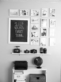 Combining a chalk board, photo wall, old cameras & typewriters.