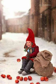 A red-capped child in wintry scene