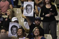 Supporters hold a poster of Hillary Clinton with a target over it at a rally for Republican presidential nominee Donald Trump in the Robarts Arena of the Sarasota Fairgrounds on November 7, 2016 in Sarasota, Florida. Hillary Clinton and Donald Trump launched into the frenzied final day of their historic fight for the White House Monday, with blow-out rallies in the handful of swing states that will decide who leads the United States. / AFP / MANDEL NGAN (Photo credit should read MANDEL…