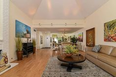 Sitting pretty on the greenbelt this move in ready Harvard plan features 16' high vaulted ceilings providing a light and bright ambiance throughout the living/dining great room. Move in and enjoy all that Campus Commons has to offer.  MLS # 17059879 . . .