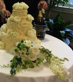 Beautiful cream cheese and white roses wedding cake. Atdweddingandeventflowers.com