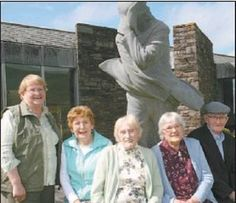 Five of the ten living people who were born on the Great Blasket gathered beneath a sculpture of writer Tomás Ó Criomhthain at...