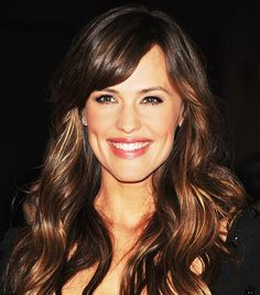 If you have thick hair, bangs aren't your enemy—we promise. But if you're not loving the look of blunt bangs, try growing them a bit longer and sweeping them to the side like Jen Garner so...