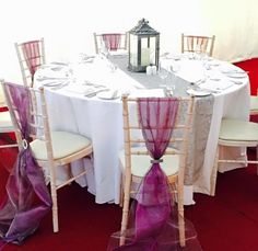 Wedding breakfast set up with purple organza sashes, bronze detailing centre of drop.  Want your own quote? Then email me with your ideas! hello@beckiemelvinevents.co.uk  More styles can be seen at www.beckiemelvinevents.co.uk