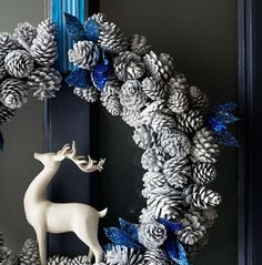 For a truly contemporary door wreath, spray paint pine cones white and add subtle blue accents with ribbon and sparkly painted leaves.