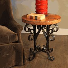 The Iron Scroll Accent Table is lovely in a Tuscan inspired living space, $670.00