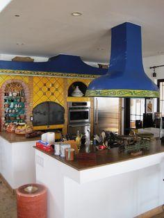 Free-hanging hood in rustic open  kitchen