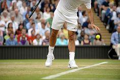 Roger Federer prepares to serve