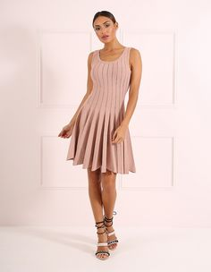 A nude bandage skater dress is sure to be your go-to ensemble throughout the season. The fit and flare hem works to cinch your waist, whilst the sexy laddered texture gives this dress the added wow factor.