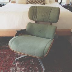 in process-vintage army surplus upholstery on an eames recliner by MODERNHAUS