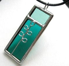 LOVE this stained glass pendant