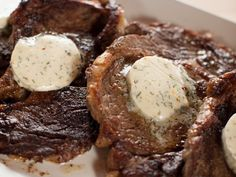 Cowboy/Hotel Butter on Steak. I grilled my steaks with salt and pepper. 3/4 cup softened, salted butter. Half a clove of garlic finely minced. A handful of parsley finely minced. A squirch of lemon juice. A dash of red pepper and a touch of black pepper... I think that's all I put in my impromptu version. Served with wedge salad and baked potatoes with broccoli and cheddar sauce. Perhaps a roll would have been nice.