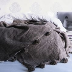 Moroccan wool pom pom blanket