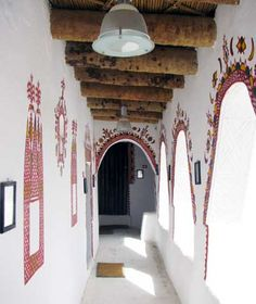Ghadames house corridor, with red paint designs on white walls. (Berber style.)