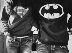 Wow...this is awesome! Why? Because that's just like me and my boyfriend...except I'm in the Batman shirt and he's in the Superman shirt. :)