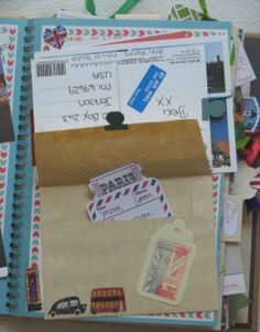 Love how she washi taped the postcard down only on the top and hid an envelope of tickets under it.