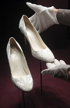 Kate's bridal shoes - custom made by Alexander McQueen's Sarah Burton to match her wedding dress, Kate's elegant pumps are made of ivory duchesse satin with lace hand-embroidered by the Royal School of Needlework.