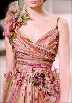 love the fabric.  Would be fun to find a beautiful fabric dress that's plain and cut the bottom off and use the extra fabric to make the matching flowers