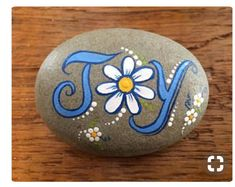 Joy, daisy, flower painted rock