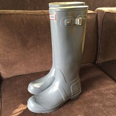 Hunter gloss tall rain boots 100% auth. Sz 10-11 100% authentic Hunter rain waterproof boots finished in medium grey. These have been well cared for and the only defect is that 1 buckle strap is missing but that is more cosmetic than functional. They are size UK 8 which is us 9 men's and women's 10 and eur 42. These will fit 10-10.5 possibly 11 women's since they run big. Hunter Shoes Winter & Rain Boots