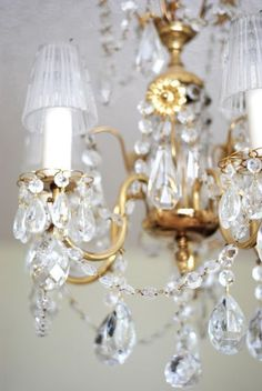 Pretty little crystal shades make this chandelier special Chandelier Bougie, Candle Chandelier, Antique Chandelier, Chandelier Lighting, Crystal Chandeliers, Chandelier Ideas, Shabby Chic Candle, Elegant Homes, Candlesticks