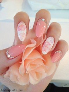 soft pink nails with glitter would want the glitter on top with the design on one ring finger.