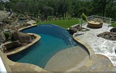 "More photos of this project can be found by visiting www.masterpoolsguild.com & click on the ""Featured Pools"" Gallery.  This design by Geremia Swimming Pools is breathtaking - you MUST see all the photos on the site."