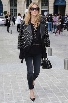 For The Downtown Girl - Arriving at the Alexis Mabille Couture show in skinny jeans, a lace-up black blouse and a studded leather jacket.