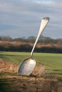 installation art amazing funny giant land public art installation out in the countryside , a massive spoon take a slice out the country and get a taste of nature is the theme no doubt , must have people flocking for miles to see it , either that or some giant accidentally dropped his porridge spoon and no one wants to move it in case he comes back to find it