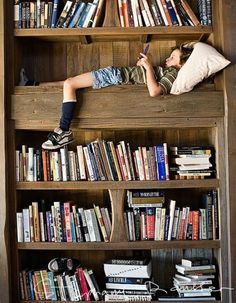 This would have totally been me as a kid! Heck, if I could find a bookshelf big enough, this would be me now! (except that'd be a book in my hands) :)