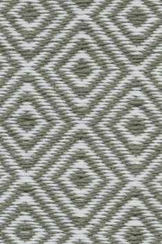 Diamant in Green Olive. The diamond motif has graced textiles, pottery and construction across many cultures. Diamant is a Scandinavian-inspired design that makes a simple and sophisticated statement.