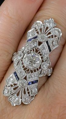 A magnificent antique Art Deco dinner ring at Lang Antiques. Sapphires and diamonds in platinum filigree, circa 1920s.
