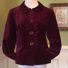 "NWOT Burgundy Velour Jacket Super cute. Ruffle front and bottom closure. Front pockets. Rounded collar. Pleats in back has shown in pic. This is a Jrs Large fits like a size 8. Measures 21"" shoulder to hem. 19"" bust area and 18"" waist. Excellent Condition!!! Halogen Jackets & Coats"