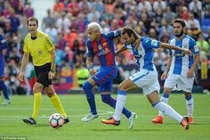 Brazilian attacker Neymar, 24, vies with Leganes defender Victor Diaz during the La Liga encounter on Saturday